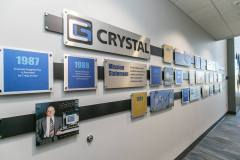Metal cut custom timeline for Crystal Group