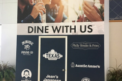 Dine with us sign